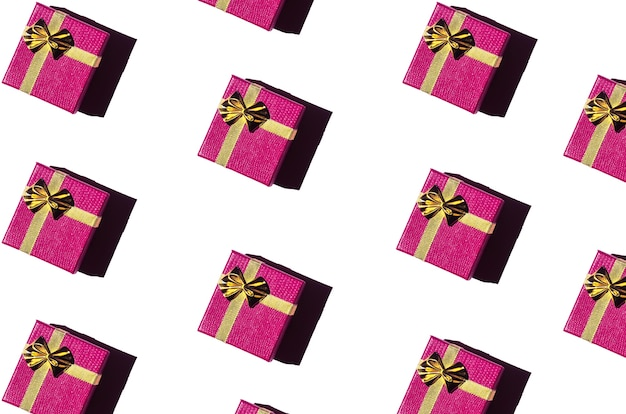 Magenta gift boxes on a white background