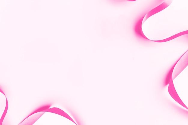 マゼンタのピンクのリボンの模様の背景