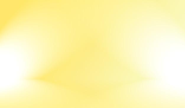 輝く黄色のグラデーションスタジオの背景の魔法の抽象的な柔らかな色。