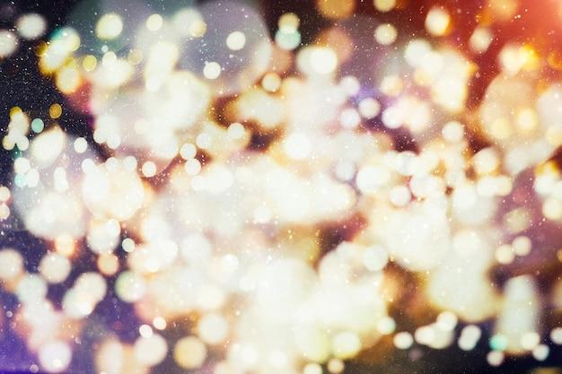 色付きの魔法の背景自然なボケ味と明るい金色の光でお祝いの背景。ヴィンテージマジックの背景
