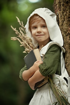 Magic childhood. miracles happen. a little fairy girl walks through an incredibly beautiful green forest. bedtime stories.