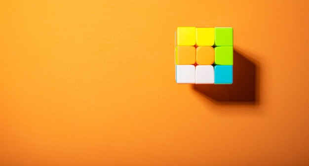 Magic cube on an orange eva surface and hard light, top view