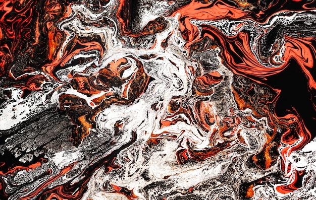 魔法のオレンジ-赤-金色。美しい大理石の効果。古代の東洋の描画技術。
