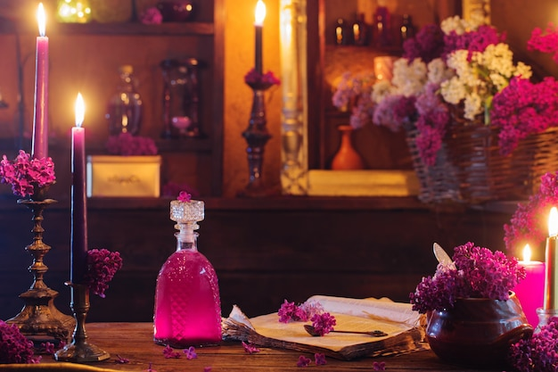 Magic potion of lilac flowers in the witch's house