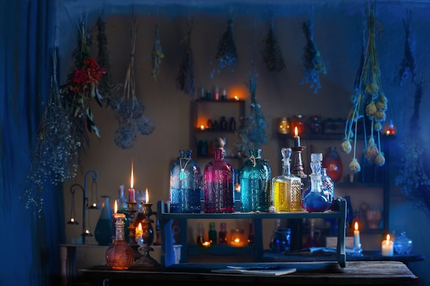 Magic potions in  witch's house with burning candles at night