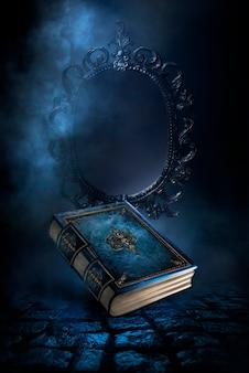 어두운 배경에 있는 마법의 빈티지 판타지 책, 예측과 운세의 마법 거울, 연기, 안개, 어둠 속에서 네온 달빛. 3d 그림입니다.