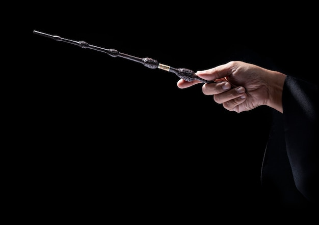 Magic wand in black.miracle magical stick wizard tool.
