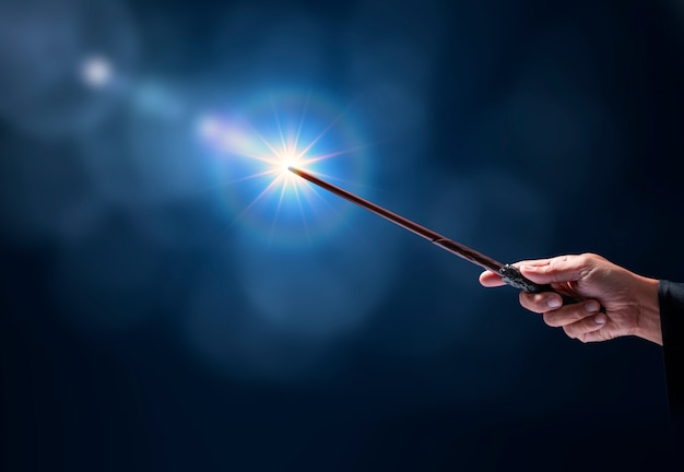 Magic wand with sparkle on blue background