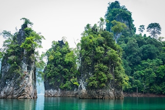 Magical landscape with limestone pillar over water