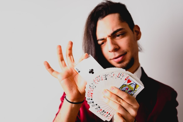 Magician doing tricks with a deck of cards.
