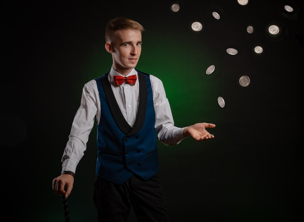 The magician is the guy with the open hand throwing coins