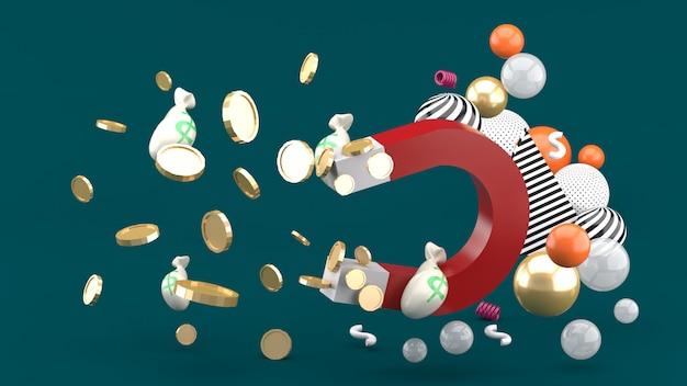 磁石は緑のスペースでカラフルなボールの間でお金を吸います