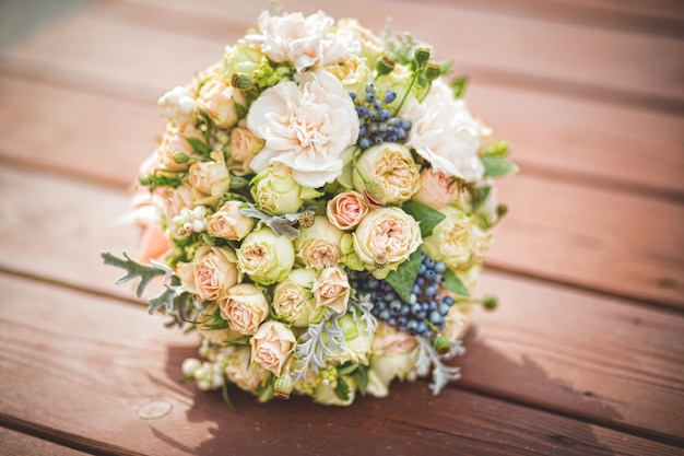 Magnificent bouquet in soft colours with roses and berries