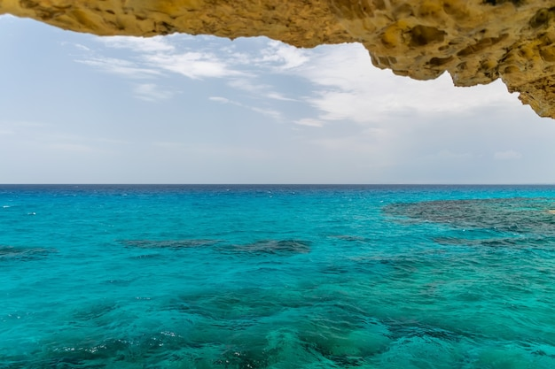 Magnificent view of the horizon from a cave on the shores of the mediterranean sea.