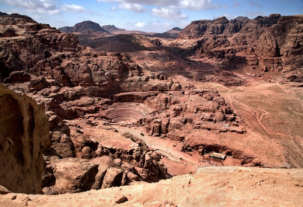 Magnificent view of petra, jordan. the amphitheatre cut into the rock and ancient rock caves