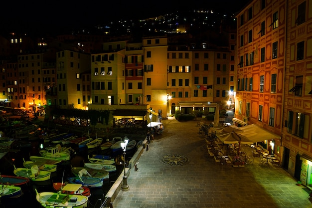 Magnificent view of the small port in camogli lights and colors are reflected on the sea creating a