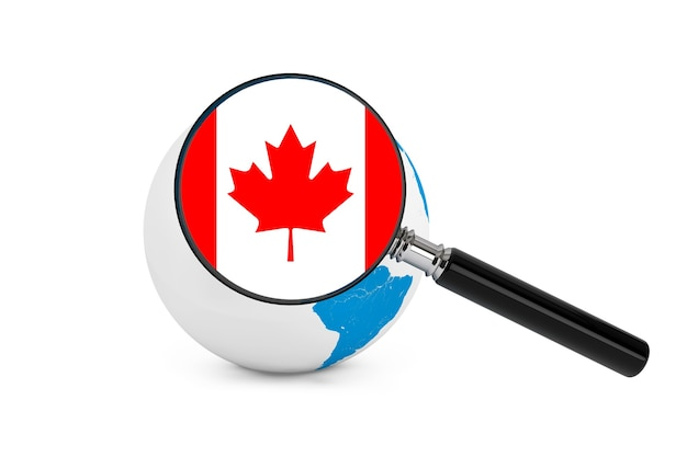白い背景の上の地球儀とカナダの拡大旗 Premium写真