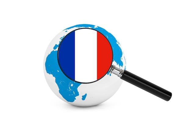 白い背景の上の地球儀とフランスの拡大旗 Premium写真