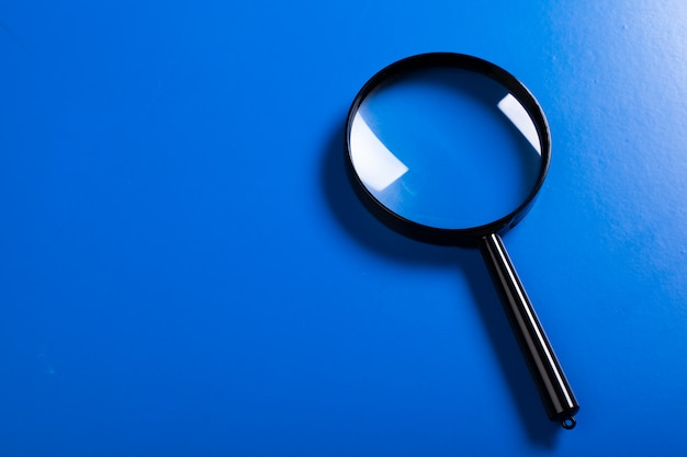 Magnifier on blue close up