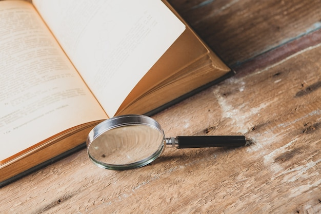 Magnifier and book. concept study material
