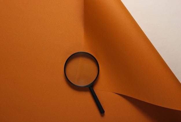 Magnifier on brown paper