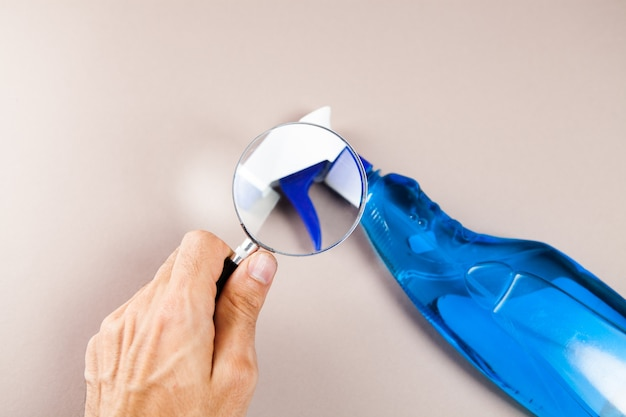 Magnifier and detergent on the table