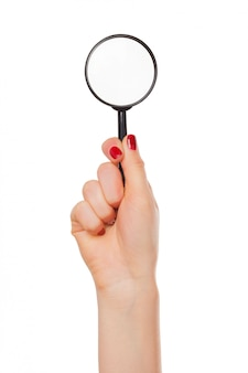 고립 된 여자 손에 돋보기 유리 프리미엄 사진