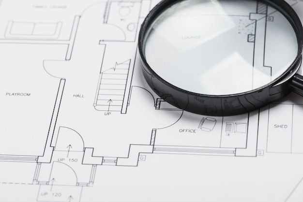 Magnifying glass on blueprint