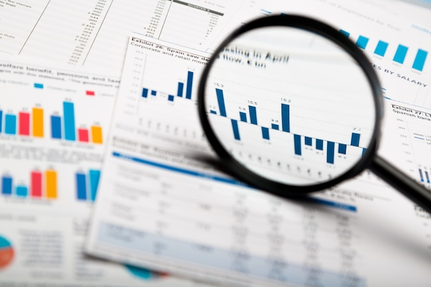 Magnifying glass and business growth graph ,business concept.