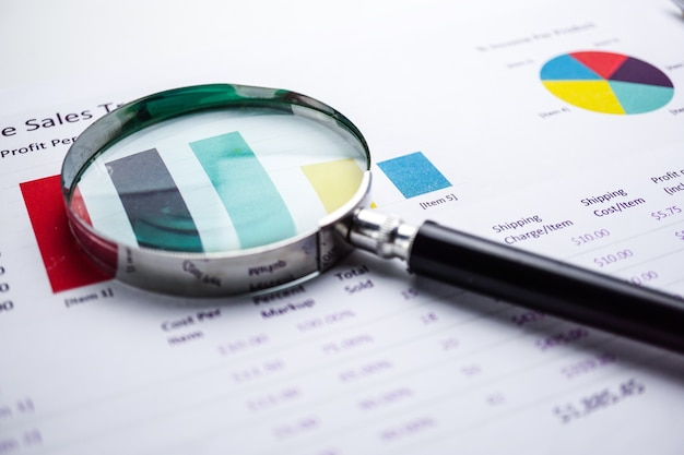 Magnifying glass on chart graph. financial, account, statistics, analytic economy, busines