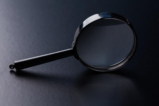 Magnifying glass on dark
