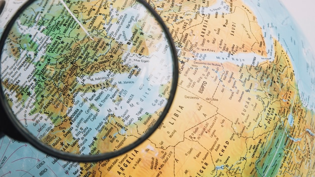 Magnifying glass over europe on globe
