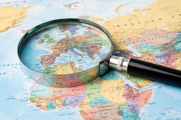 Magnifying glass on europe map