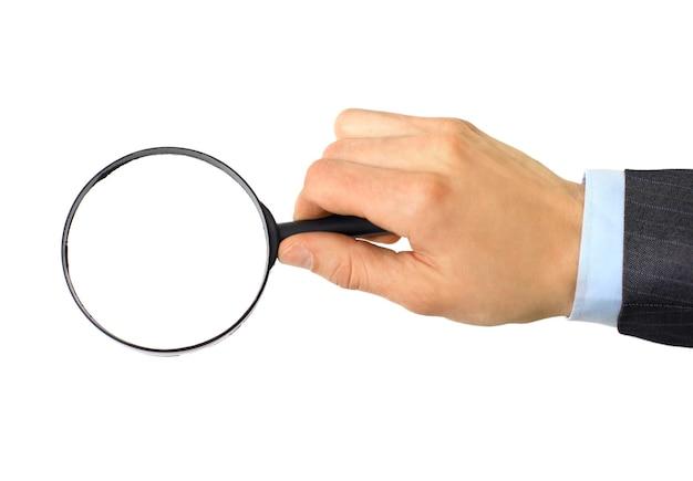 白い背景で隔離の手に拡大鏡