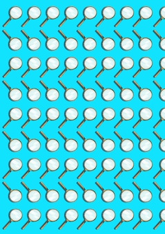 Magnifying glass isolated on blue. abstract pattern of many objects