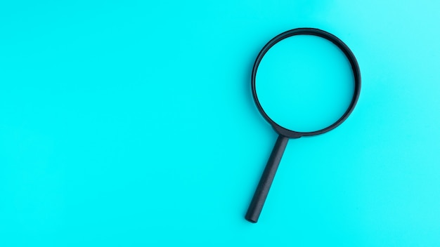 Magnifying glass isolated on blue background