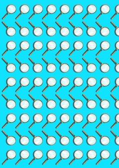 돋보기 파란색에 격리입니다. 많은 개체의 추상 패턴