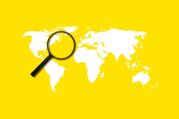 Magnifying glass loupe search on yellow surface. added world map.