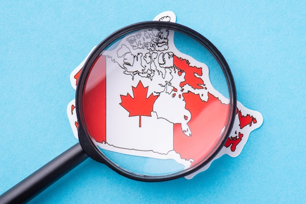Magnifying glass on the map of canada