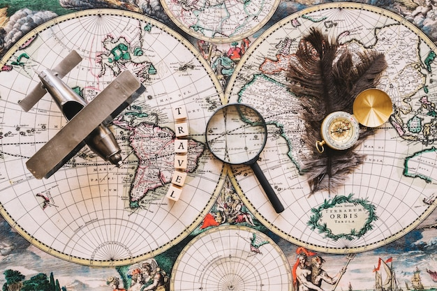 Magnifying glass near travel writing and tourist stuff
