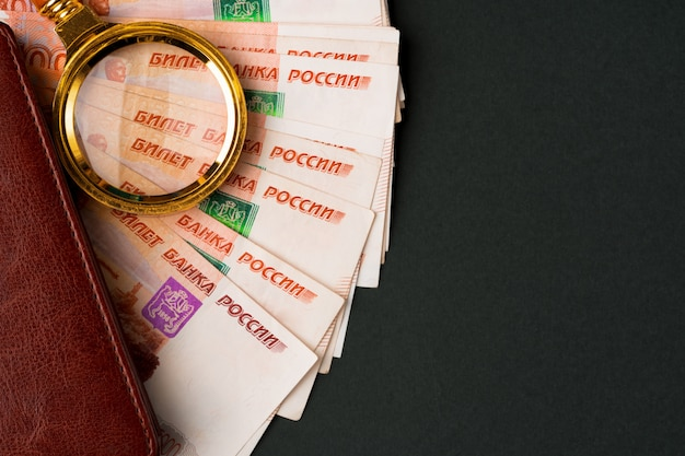Magnifying glass on the russian currency rubles