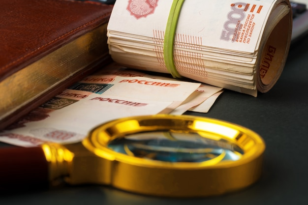 Magnifying glass on the russian currency