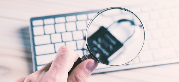 Magnifying glass search open or password on laptop