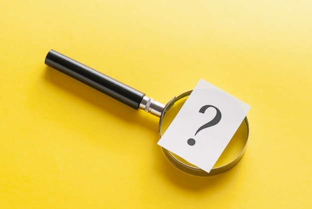 Magnifying glass with question mark on yellow