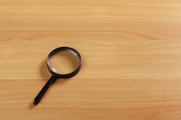 Magnifying glass on the wood