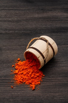 Magyar (hungarian) brilliant red hot paprika powder. traditional seasoning for cooking national food. wooden keg, copy space