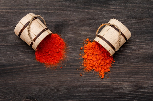 Magyar (hungarian) brilliant red sweet and hot paprika powder. traditional seasoning for cooking national food. wooden kegs