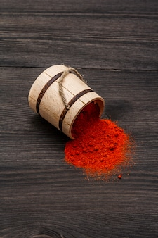 Magyar (hungarian) brilliant red sweet paprika powder. traditional seasoning for cooking national food. wooden keg