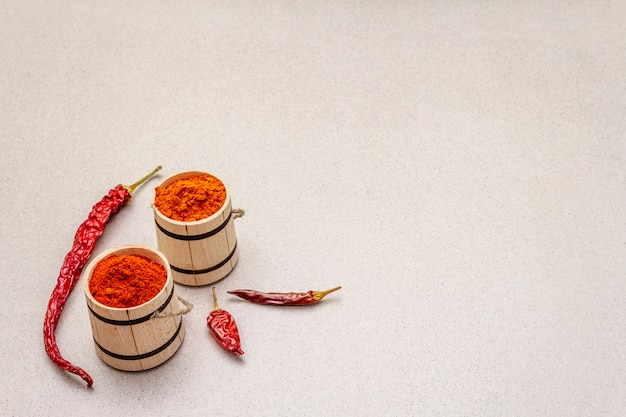 Magyar (hungarian) red sweet and hot paprika powder. traditional seasoning for cooking national food, different varieties of dry pepper. wooden kegs,