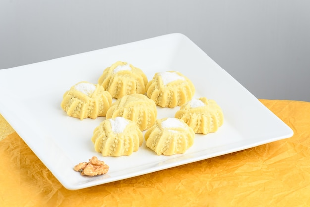 Mahmoull a typical arabic sweet isolated on yellow background